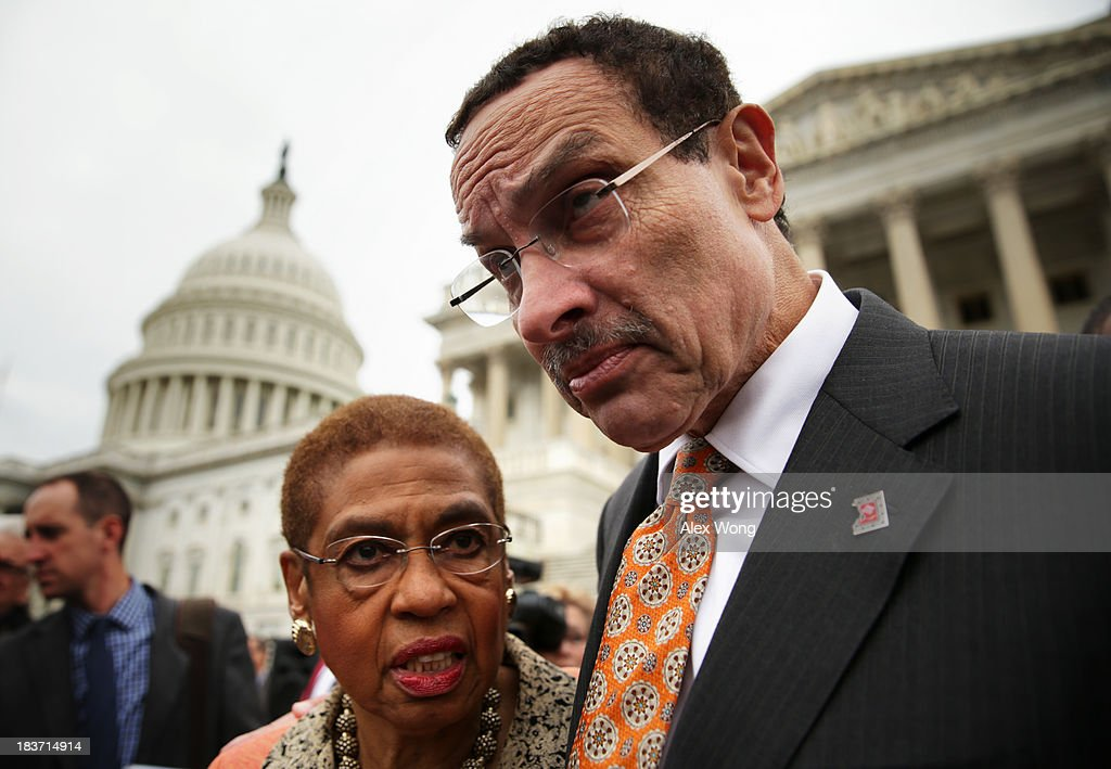 Washington, DC Mayor Vincent Gray (R) listens to Delegate <a gi-track='captionPersonalityLinkClicked' href=/galleries/search?phrase=Eleanor+Holmes+Norton&family=editorial&specificpeople=642872 ng-click='$event.stopPropagation()'>Eleanor Holmes Norton</a> (D-DC) after a news conference with members of the D.C. Council 'to call on the Senate and the administration to free DC's local budget during the federal government shutdown' at the Senate Swamp October 9, 2013 on Capitol Hill in Washington, DC. On the ninth day of a government shutdown, Senate Democrats said they will negotiate with the Republicans after the government reopens.