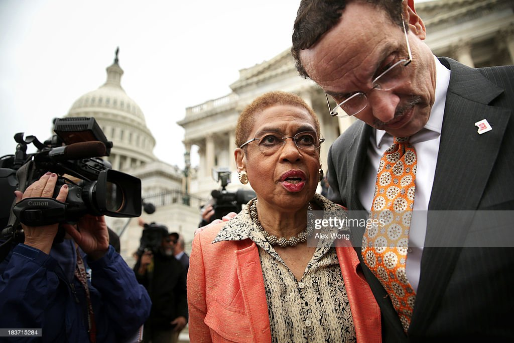 Washington, DC Mayor Vincent Gray (R) listens to Delegate <a gi-track='captionPersonalityLinkClicked' href=/galleries/search?phrase=Eleanor+Holmes+Norton&family=editorial&specificpeople=642872 ng-click='$event.stopPropagation()'>Eleanor Holmes Norton</a> (D-DC) after a news conference with members of the D.C. Council 'to call on the Senate and the administration to free D.C.'s local budget during the federal government shutdown' at the Senate Swamp October 9, 2013 on Capitol Hill in Washington, DC. On the ninth day of a government shutdown, Senate Democrats said they will negotiate with the Republicans after the government reopens.