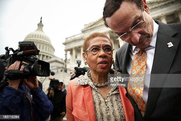 Washington DC Mayor Vincent Gray listens to Delegate Eleanor Holmes Norton after a news conference with members of the DC Council 'to call on the...