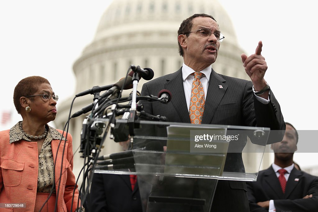 Washington, DC Mayor Vincent Gray (C) speaks as Councilmember Kenyan McDuffie (R) and Delegate <a gi-track='captionPersonalityLinkClicked' href=/galleries/search?phrase=Eleanor+Holmes+Norton&family=editorial&specificpeople=642872 ng-click='$event.stopPropagation()'>Eleanor Holmes Norton</a> (D-DC) listen during a news conference with members of the Washington, DC Council 'to call on the Senate and the administration to free DC's local budget during the federal government shutdown' at the Senate Swamp October 9, 2013 on Capitol Hill in Washington, DC. On the ninth day of a government shutdown, Senate Democrats said they will negotiate with the Republicans after the government reopens.