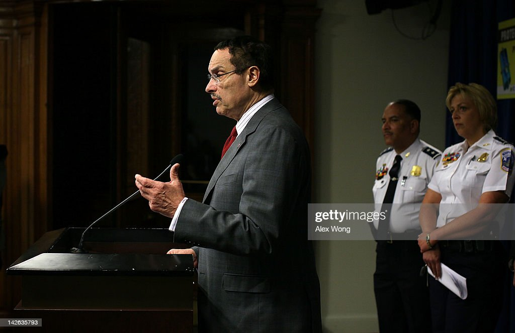 Washington, DC, Mayor Vincent Gray (L) speaks as Washington, DC, Metropolitan Police Department Chief Cathy Lanier (R), and Washington, DC, Metro Transit Police Chief Michael Taborn (2nd R) listen during a news conference to announce 'a major wireless industry agreement to combat cell phone theft and related crimes' April 10, 2012 at the Wilson Building in Washington, DC. The news conference was to announce initiatives to combat the growing robbery rate targeting smartphones and other cell phones.