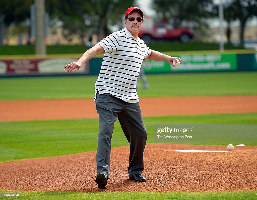 Washington DC Mayor Vincent Gray throws out the first pitch before the Florida Marlins tie the Washington Nationals 2 -2 in 10 innings during Grapefruit League baseball in Viera FL, February 24, 2012 .