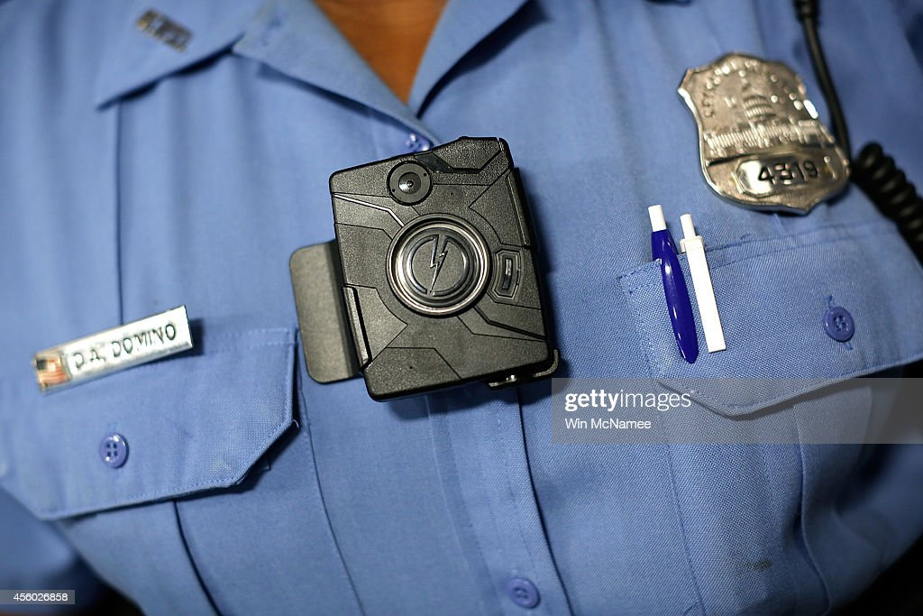 Washington DC Metropolitan Police Officer Debra Domino wears one of the new 'bodyworn cameras' that the city's officers will begin using during a...