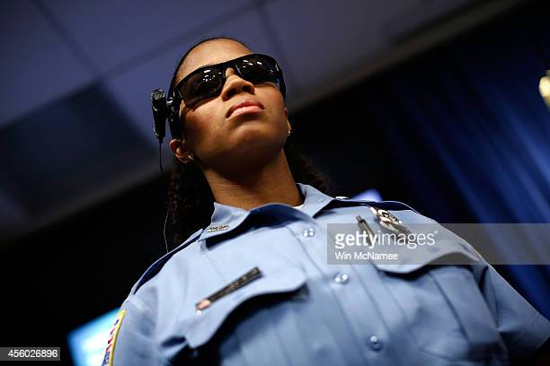 Washington DC Metropolitan Police Officer JaShawn Colkley wears one of the new 'bodyworn cameras' that the city's officers will begin using during a...