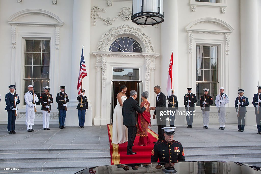 Washington DC On Tuesday August 2 First Lady Michelle Obama and President Barack Obama greet Singapore Prime Minister Lee Hsien Loong and his wife...