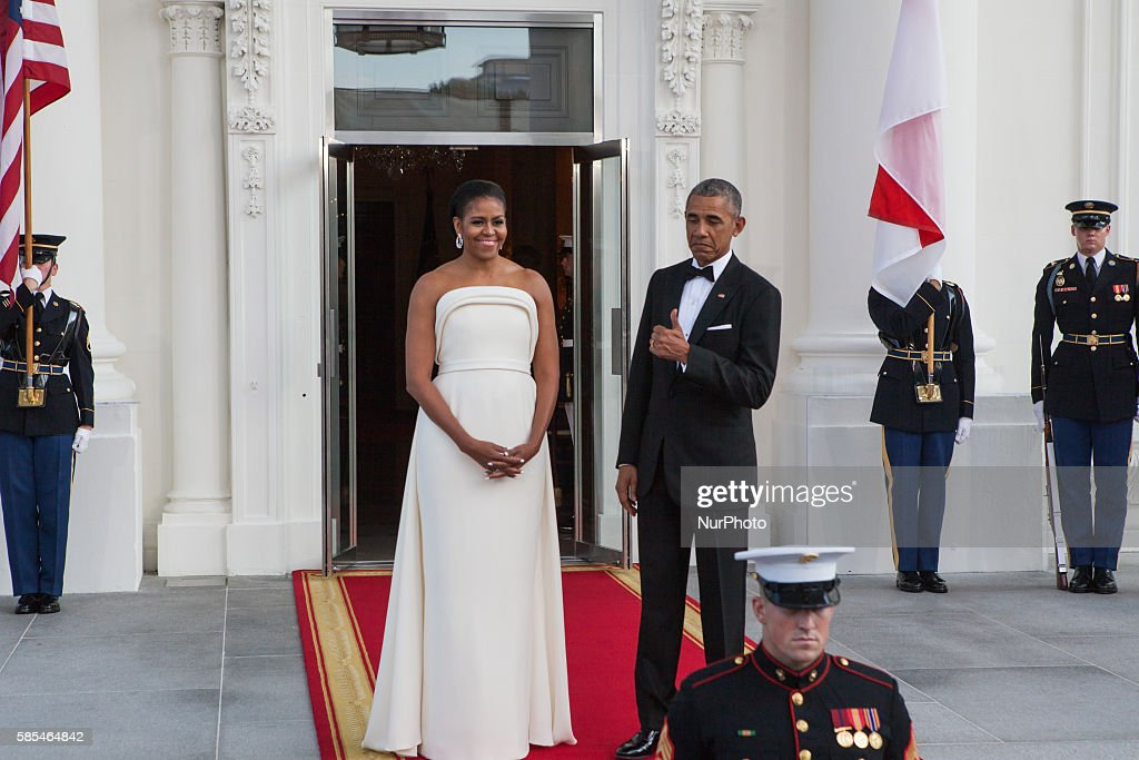 Washington DC On Tuesday August 2 on the North Portico of the White House President Barack Obama gives the sign of approval for his wife First Lady...