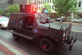 Washington DC police move in an armored vehicle to deal with protesters blocking the streets during World Bank/IMF demonstrations in Washington DC 16...