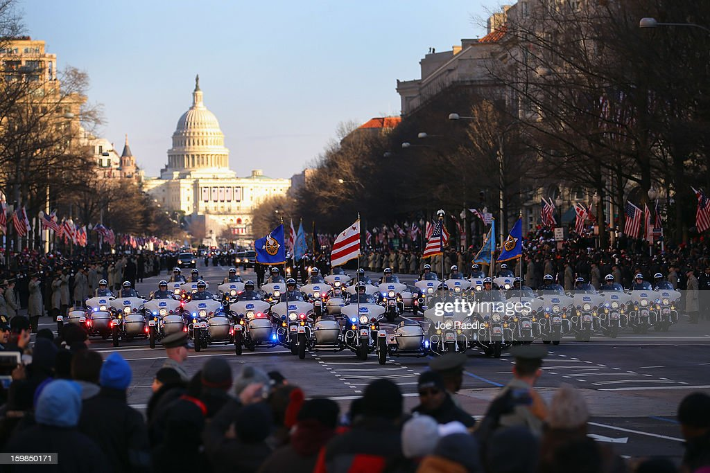 Washington DC police officers lead the inauguration parade on January 21, 2013 in Washington, DC. President Barack Obama was ceremonially sworn in for a second term office during a public ceremony at the U.S. Capitol building.
