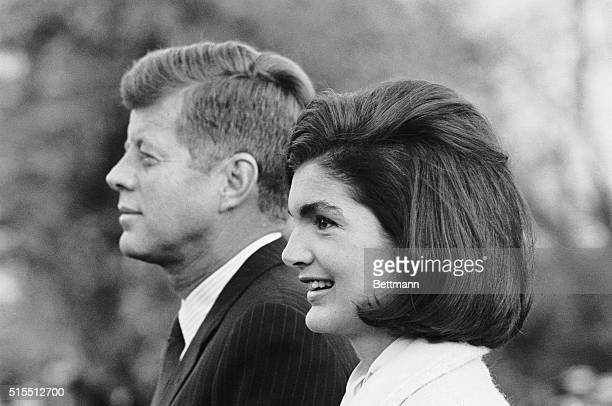 President and Mrs Kennedy are shown on the South Lawn of the White House just prior to a performance by the Black Watch Royal Highland Regiment The...