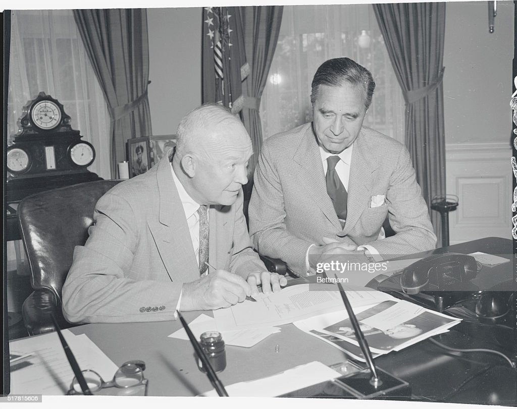 Senator Prescott Bush looks on as President Eisenhower approves his bill which provides for a survey of the East Coast of the US to see what measures...