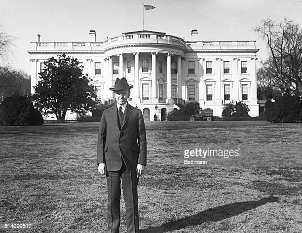 The White House showing President Coolidge standing on the South lawn