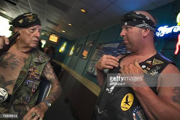 War veteran of World War II Korea and Vietnam Elton Ensor meets Staff Sgt Kevin McKim of Fort Brag NC who's been deployed in Iraq as they exchange...