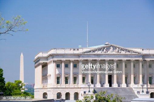 USA, Washington DC, U.S. Senate side of U.S. Capitol with Washington Monument in background : Stock Photo