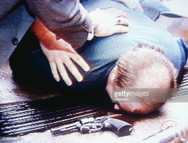 White House press secretary Jim Brady lies wounded on sidewalk after a gunman fired several shots at President Ronald Reagan and his party after he...