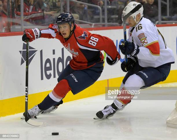 Washington defenseman Nate Schmidt left gainst control of the puck against Florida center Aleksander Barkov as the Washington Capitals play the...
