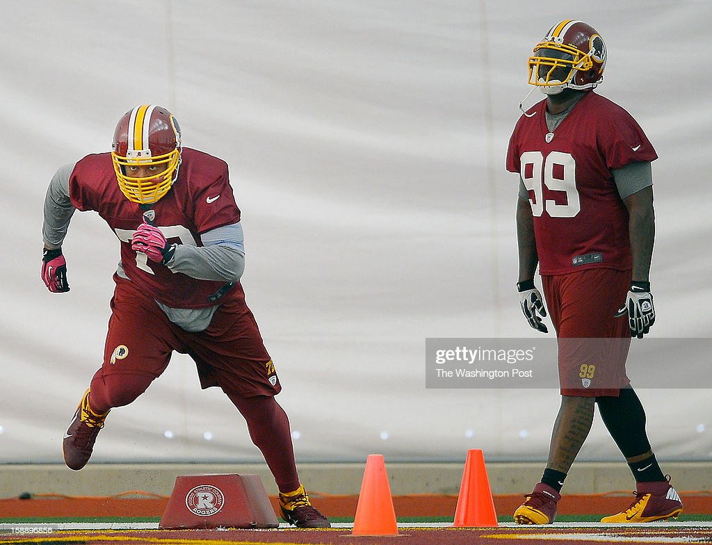 Washington defensive ends Stephen Bowen (72), left, and Jarvis Jenkins (99) take part in drills as the Washington Redskins practice for the upcoming playoff game against the Seattle Seahawks in their indoor practice facility at Redskins Park in Ashburn VA, January 2, 2012 .
