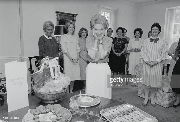 First Lady nancy Reagan admires her birthday cake at the White House presented to her by her staff in celebration of her 60th birthday