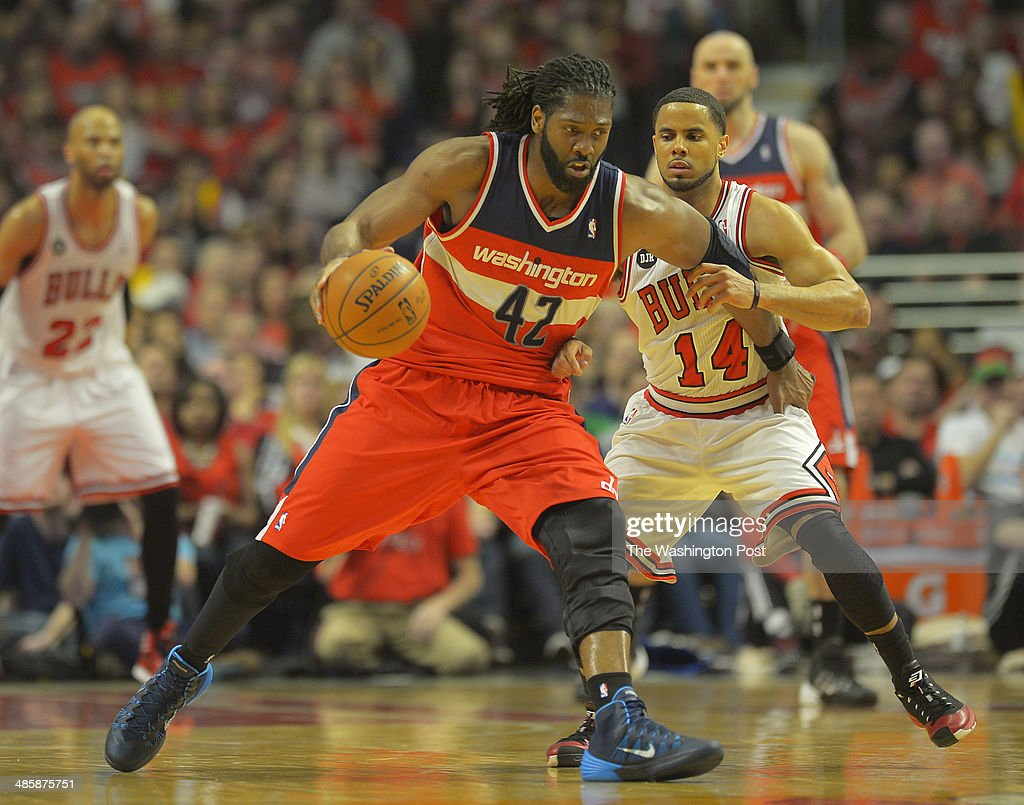 Washington forward Nene (42), center, controls the ball against Chicago guard D.J. Augustin (14) as the Washington Wizards play the Chicago Bulls in game 1 of the Eastern Conference quarter finals at the United Center in Chicago IL, April 20, 2014.