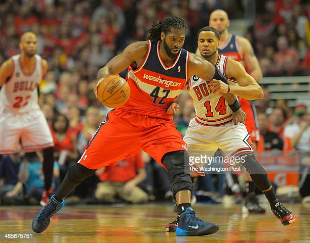 Washington forward Nene center controls the ball against Chicago guard DJ Augustin as the Washington Wizards play the Chicago Bulls in game 1 of the...