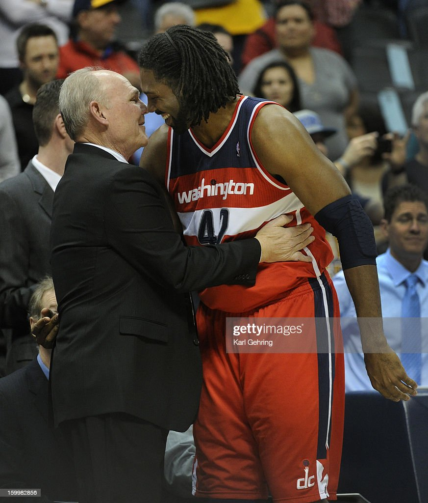 Washington forward Nene greeted his former coach George Karl at the start of the contest Friday night. The Denver Nuggets hosted the Washington Wizard at the Pepsi Center Friday night, January 18, 2013. Karl Gehring/The Denver Post via Getty Images