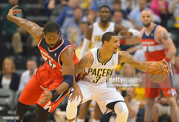 Washington forward Nene Hilario left just misses getting turnover against Indiana guard George Hill as the Washington Wizards play the Indiana Pacers...