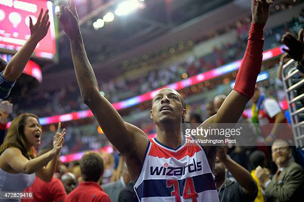 Washington forward Paul Pierce walks off the court after he hit the game game winning shot at the buzzer during the Washington Wizards defeat of the...