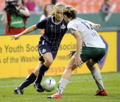 Washington Freedom forward Lene Mykjaland left works the ball past St Louis Athletica defender Elise Weber during the second half at RFK Stadium in...