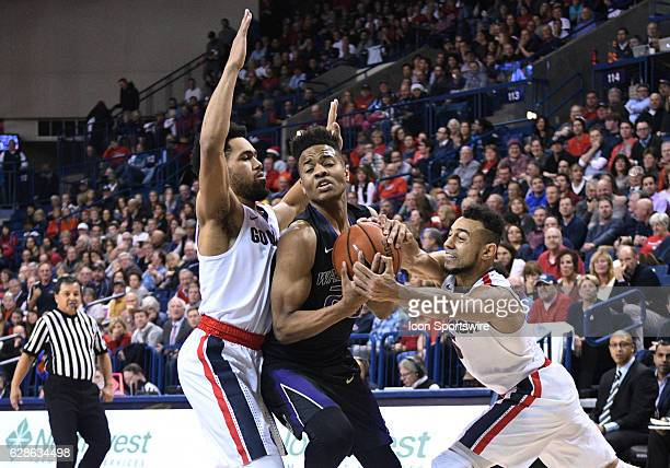 Washington freshman guard Markelle Fultz fights through this steal attempt of Gonzaga junior guard Nigel WilliamsGoss during the game between the...