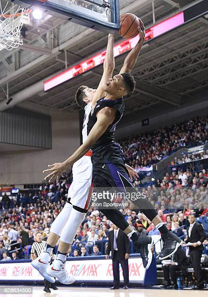 Washington freshman guard Markelle Fultz is fouled on this dunk attempt by Gonzaga freshman forward Zach Collins during the game between the...