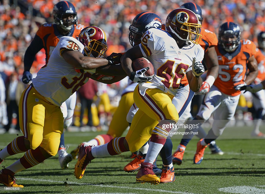 Washington fullback Darrel Young (36), left, blocks as Washington running back Alfred Morris (46) takes off for a 1st quarter first down run during the Denver Broncos defeat of the Washington Redskins 45 - 21 at Mile High Stadium in Denver CO, October 27, 2013.