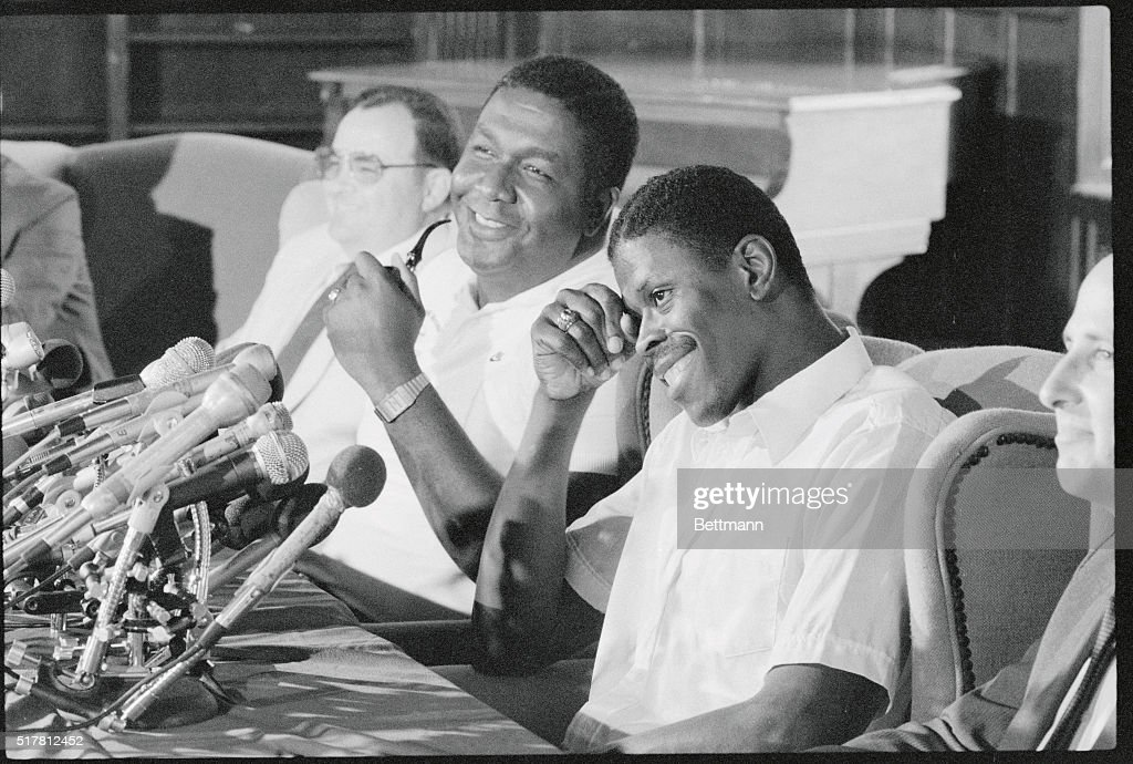 Future New York Knick Patrick Ewing and Hoyas head basketball coach John Thompson laugh during a press conference Ewing the 7foot center who is...