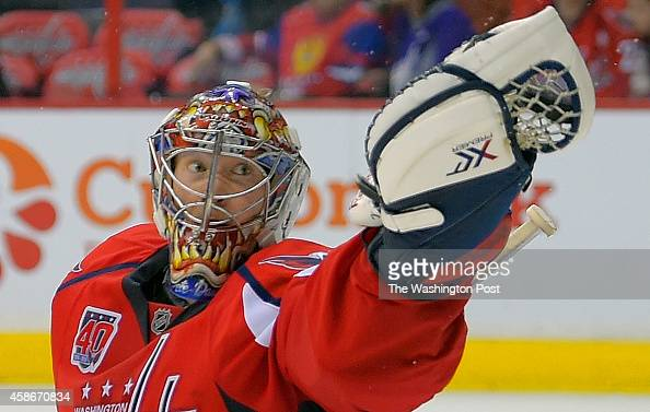 Washington goalie Justin Peters catches a Carolina shot in OT as the Washington Capitals defeat the Carolina Hurricanes 4 3 in overtime at the...