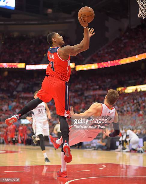 Washington guard Bradley Beal left gets a charging call against Atlanta guard Kyle Korver in the 4th quarter during the Atlanta Hawks defeat of the...