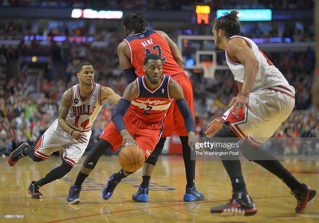 Washington guard John Wall (2), center, weaves his way around as pick set up by Washington forward Nene (42) during the Washington Wizards defeat of the Chicago Bulls 102 - 93 in game 1 of the Eastern Conference quarter finals at the United Center in Chicago IL, April 20, 2014.