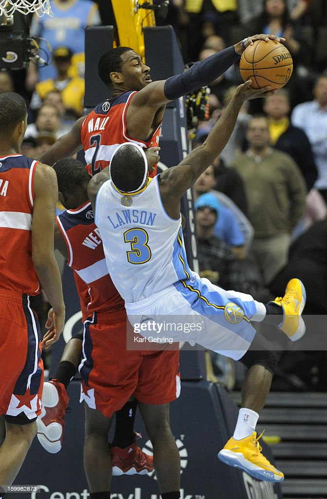 Washington guard John Wall (2) rejected a shot from Denver guard Ty Lawson in the final seconds of the the second half. The Washington Wizards defeated the Denver Nuggets 112-108 at the Pepsi Center Friday night, January 18, 2013. Karl Gehring/The Denver Post via Getty Images