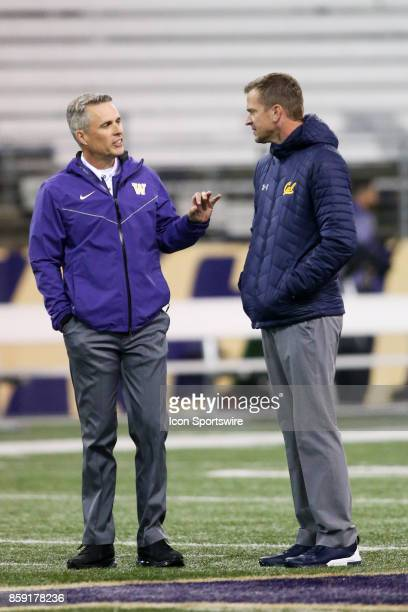 Washington head coach Chris Petersen and California head coach Justin Wilcox chat before the Washington Huskies and the California Bears on October 7...