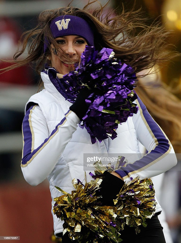 A Washington Huskies cheerleader performs on the field during the game between the Washington Huskies and the Washington State Cougars at Martin Stadium on November 23, 2012 in Pullman, Washington.