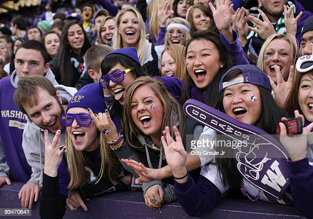 Washington Huskies fans cheer during the game against the Washington State Cougars on November 28 2009 at Husky Stadium in Seattle Washington The...