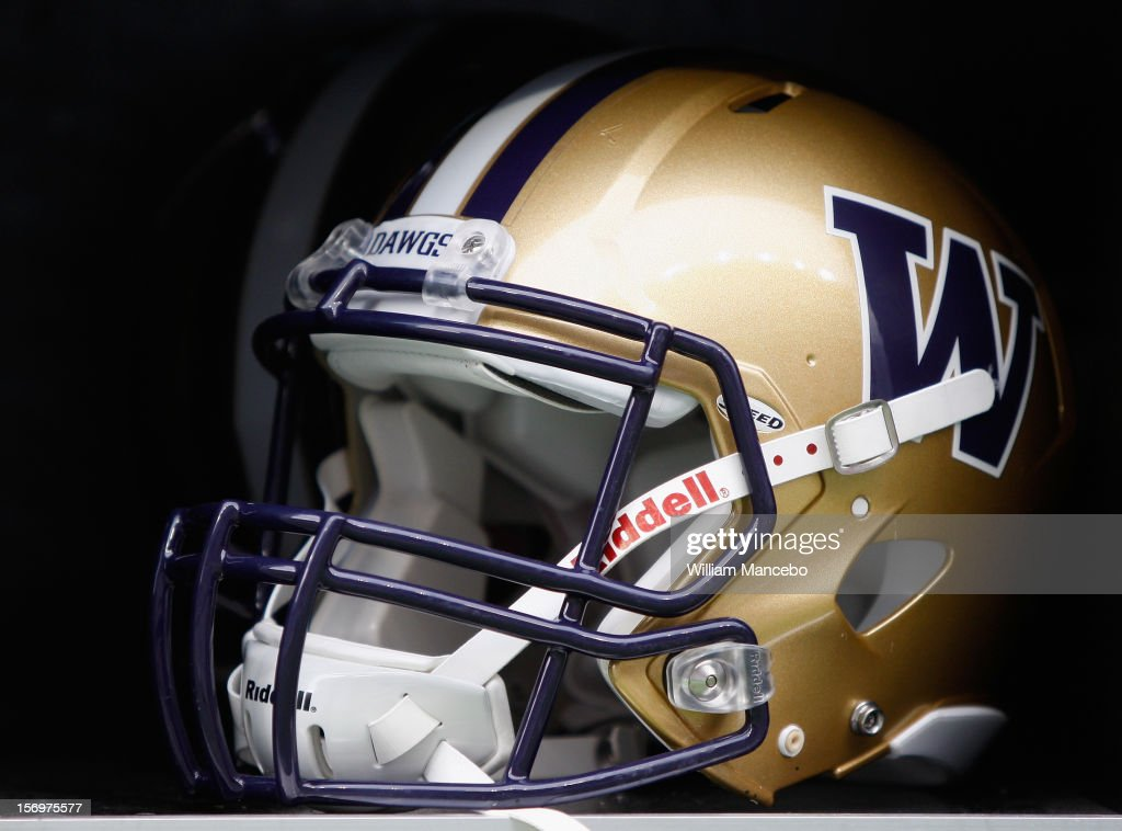 A Washington Huskies football helmet on the sidelines during the game between the Washington Huskies and the Washington State Cougars at Martin Stadium on November 23, 2012 in Pullman, Washington.