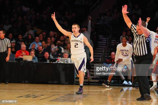 Washington Huskies guard Dan Kingma reacts after making a 3 point basket during the second half of the 2K Classic College Basketball game between the...