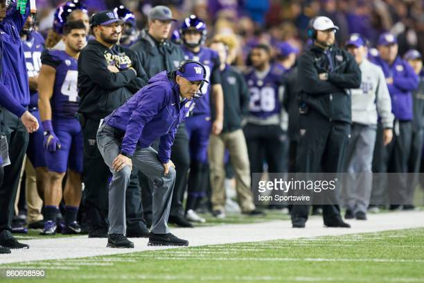 Washington Huskies head coach Chris Petersen focuses from the sidelines in the 2nd quarter of a game between the Washington Huskies and the...