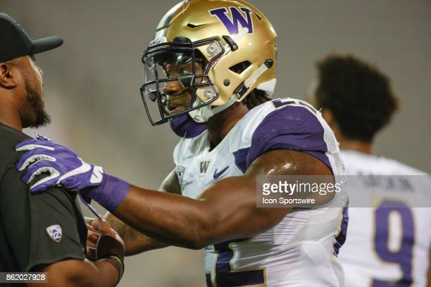 Washington Huskies running back Lavon Coleman talks to a coach before the college football game between the Washington Huskies and the Arizona State...