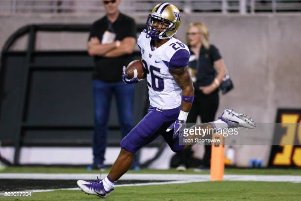 Washington Huskies running back Salvon Ahmed breaks free for a long run but is called back because of a penalty during the college football game...