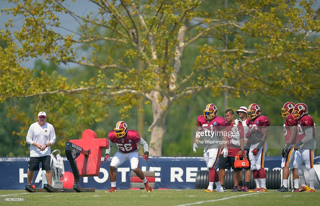 Washington inside linebacker Perry Riley center prepares to hit a blocking sled during day 5 of the Washington Redskins training camp in Richmond VA...
