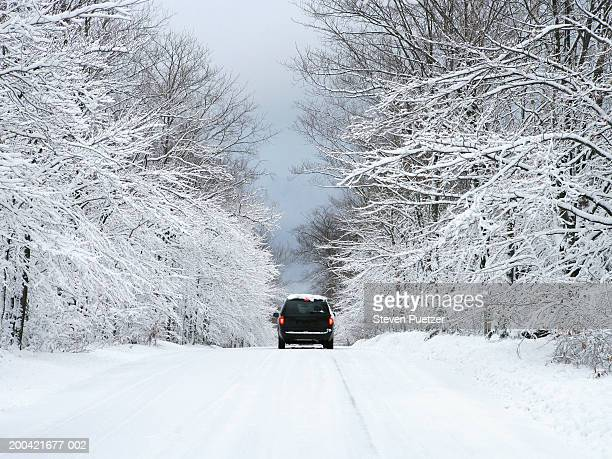 USA, Washington Island, Wisconsin, car on snow covered road