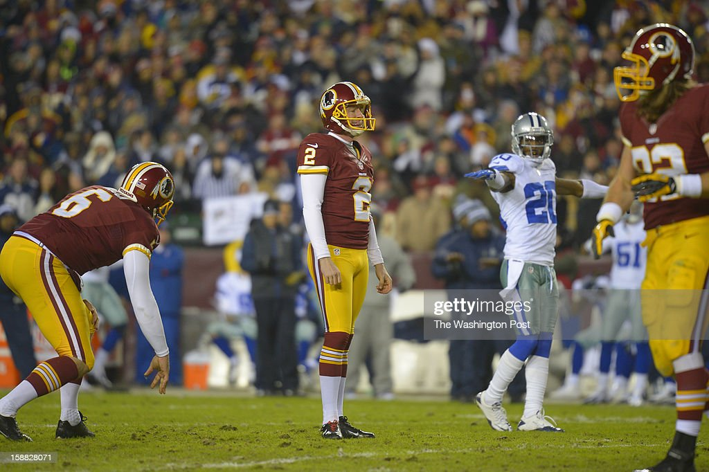Washington kicker Kai Forbath (2) reacts after missing a first-quarter field goal, his first miss after hitting 17 in a row since joining the Redskins as the Washington Redskins play the Dallas Cowboys for first place of the NFC East division and a playoff spot at FedEx in Landover MD, December 30, 2012 .