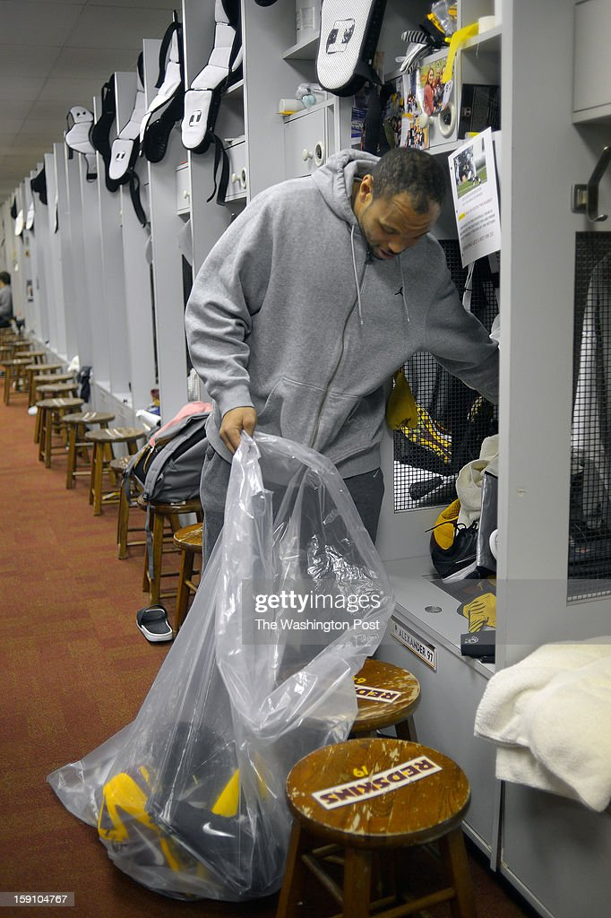 Washington linebacker Lorenzo Alexander (97) cleans out his locker at the Redskins practice facility in Ashburn Va, after their season ending loss the day before to the Seattle Seahawks in the first round of the NFC playoffs.