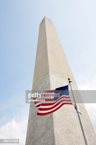 A Washington monument with the American flag
