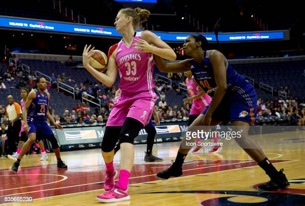 Washington Mystics center Emma Meesseman boggles the ball in front of Phoenix Mercury forward Camille Little during a WNBA game on August 18 between...