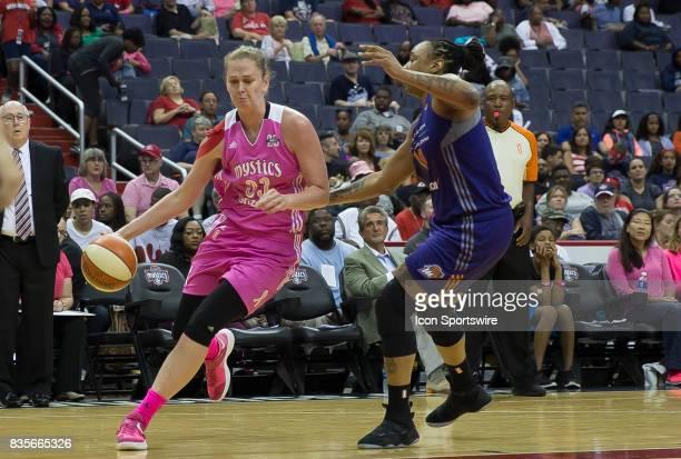 Washington Mystics center Emma Meesseman dribbles past Phoenix Mercury forward Emma Cannon during a WNBA game on August 18 between the Washington...